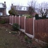 After Shot of new treated high quality sawn fence panels with concrete posts and gravel boards